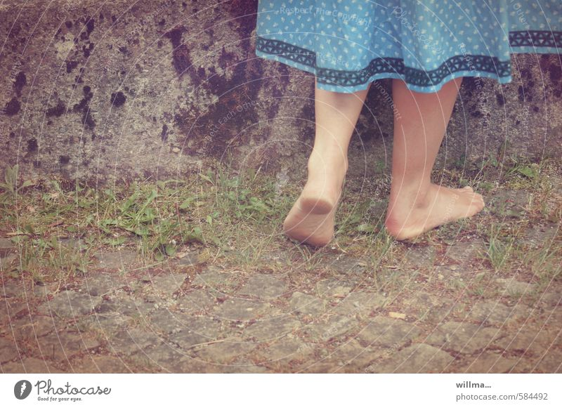 Youth (Young adults) Young woman Girl Wall (building) Grass Wall (barrier) Legs Feet Dirty Stand Cobblestones Barefoot Paving stone Rural Traditional costume