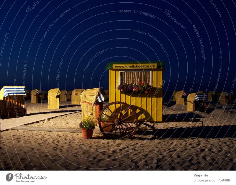 End of the performance Beach Ocean Lake Beach chair Blue Yellow Flower Night Dark Ticket Entrance sea Water beach chairs Sand dark blue flowers Evening Placed