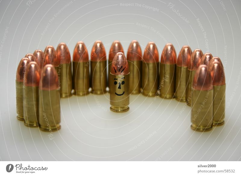 ammunition group Handgun Image type and genre Shoot Rifle Multiple Human being Munitions a personality in a group of anonymous people.