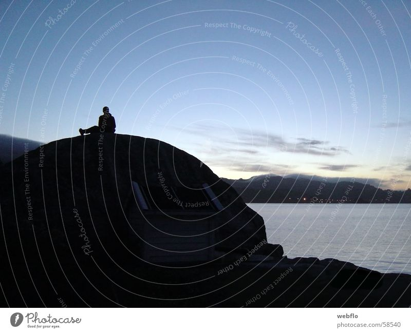 Human being Nature Water Sky Ocean Blue Black Clouds Stone Rock Extensive