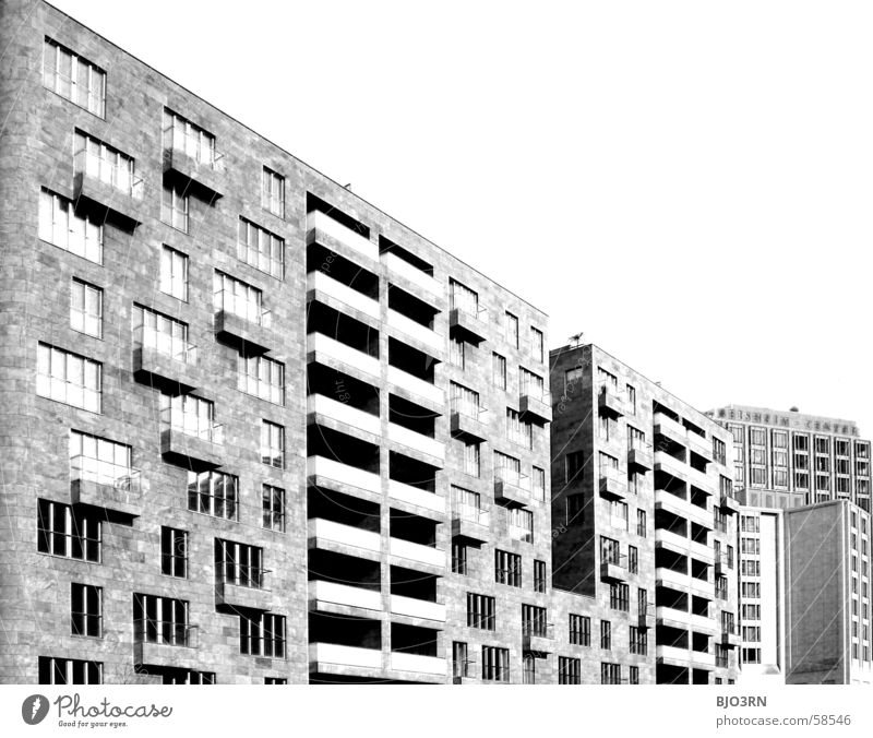 Icke in Bärlin Office building Town Window Concrete Balcony House (Residential Structure) Burnt out Infrared Black White Berlin Capital city capital Sky