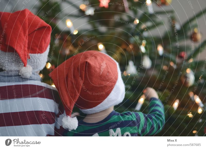 Human being Child Christmas & Advent Emotions Playing Feasts & Celebrations Moody Friendship Together Family & Relations Infancy Illuminate Cute Curiosity Cap