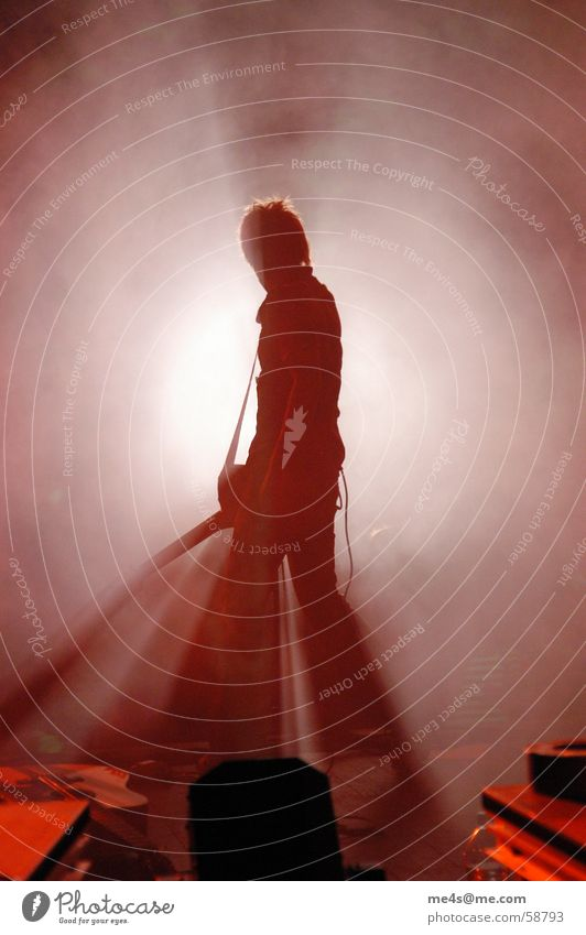 be a rockstar Concert Stage Moody Light Fog Acrobat Art Song Lead singer Singer Guitarist Pop music White Red Microphone Intensifier Back-light Man Full-length