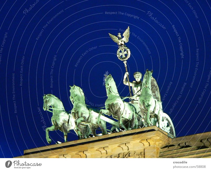 ride into the blue Pariser Platz Night Green Pedestal Eagle Bird Symbols and metaphors Landmark Monument Berlin branderburgertor Blue Lighting Lamp Human being