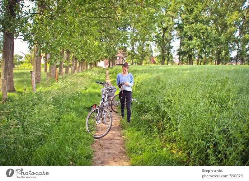 summer adventure Trip Cycling tour Camera Feminine Young woman Youth (Young adults) 1 Human being Landscape Summer Grass Meadow Bicycle Discover Going Walking
