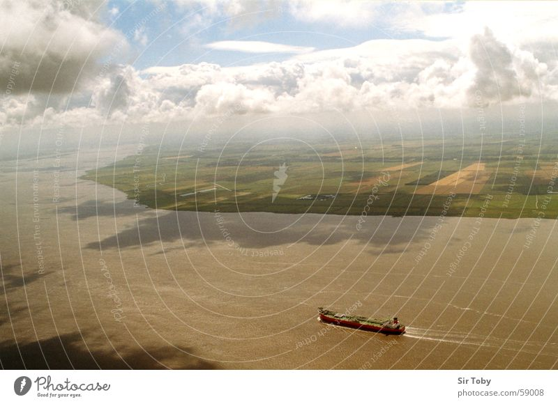 over the Elbe Aerial photograph Watercraft Clouds Bird's-eye view Schleswig-Holstein River Field Sky Far-off places Fog Landscape Horizon Clouds in the sky