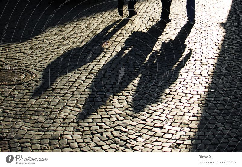 Shadows Pavement Alley Places Dark Eerie Threat 3 Deep Sunset streets Evening Feet Human being Cobblestones Paving stone