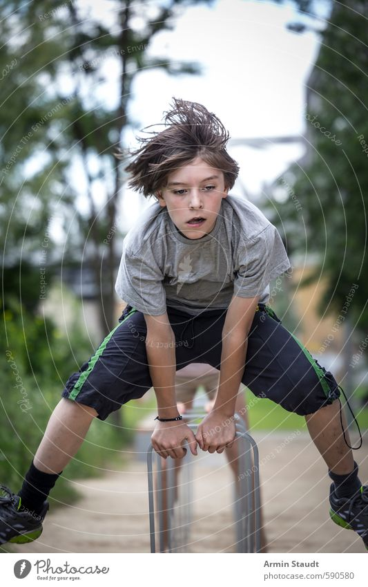 Boy jumps over a bicycle stand Lifestyle Jump Summer Sports Human being Masculine Youth (Young adults) 1 8 - 13 years Child Infancy Nature Park Berlin Town
