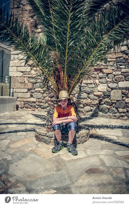 Tired tourist / boy sitting under a palm tree. Lifestyle Vacation & Travel Summer Human being Masculine Youth (Young adults) 1 8 - 13 years Child Infancy Nature