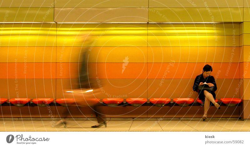 Woman Human being Motion blur Public transit Wait Walking Sit Reading Bench Station Underground Bag