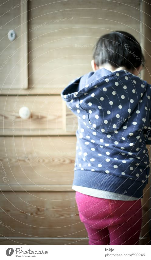 mystery Lifestyle Leisure and hobbies Playing Furniture Toddler Girl Infancy Back 1 Human being 1 - 3 years Tights Hooded sweater Polka dot Point Looking