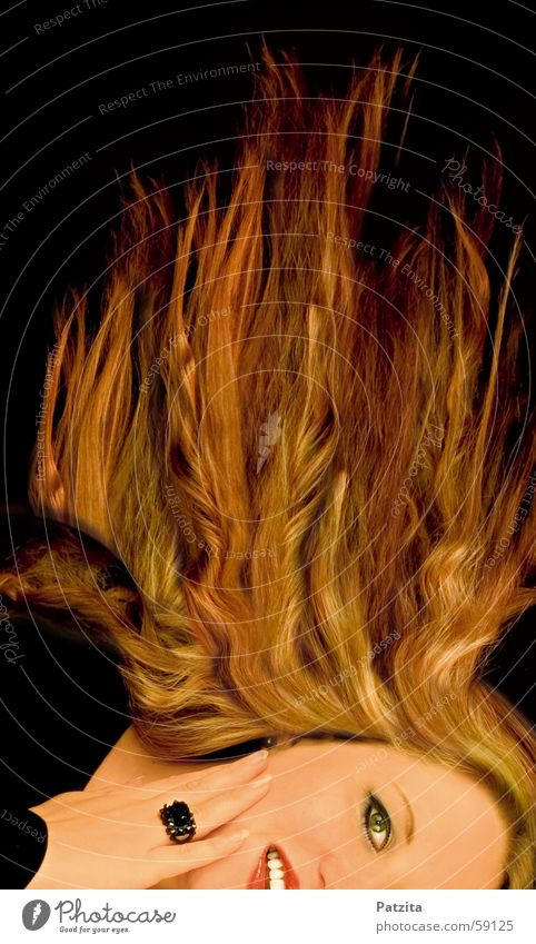 fiery Woman Portrait photograph Long-haired Black Red Yellow Hand Face Hair and hairstyles blowing hair Blaze Flame Circle Laughter