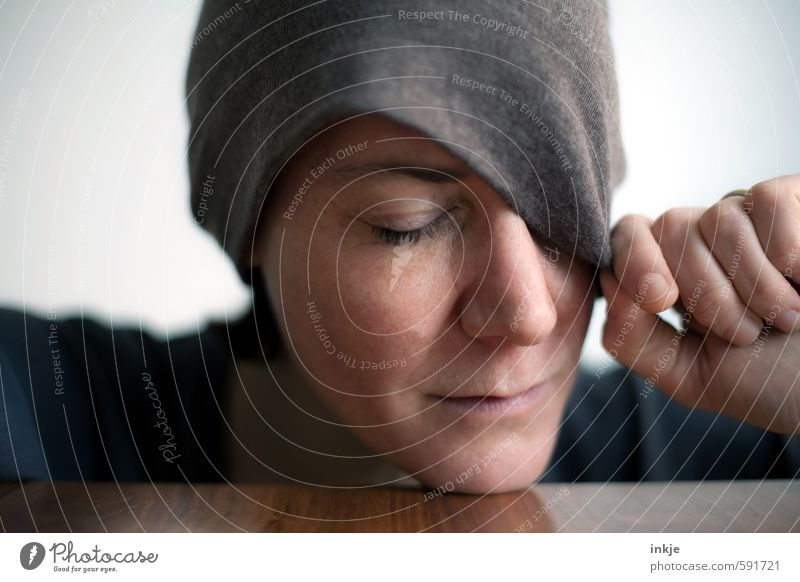 Woman with closed eyes and cap Lifestyle Style Adults Face Hand 1 Human being 30 - 45 years Cap Relaxation Sleep Dream Emotions Moody Caution Serene Calm Modest