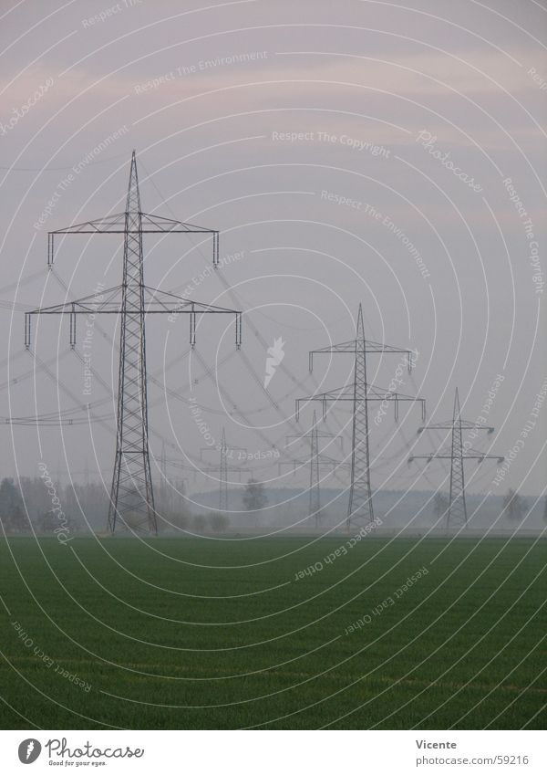 Electric 11 Electricity pylon High voltage power line High-power current Transmission lines Rustling Insulator Energy industry Tree Field Green Meadow Fog