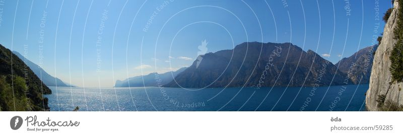 Water Sky Blue Wall (building) Mountain Stone Lake Coast Large Sailing Panorama (Format) Human being Lake Garda Optimist