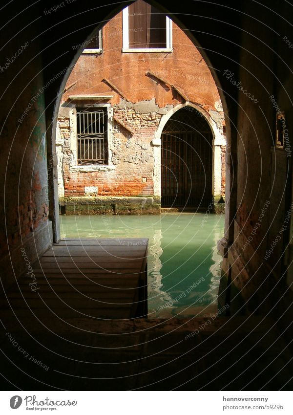 Backyard in Venice Waterway Lagoon Turquoise Archway Italy Tunnel Historic Shadow Tunnel vision Vista Old Historic Buildings Deserted Jetty Decline Channel