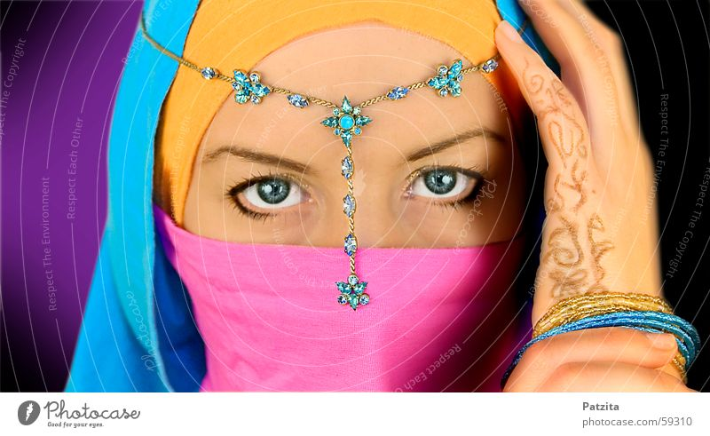 Indian Princess in color Near and Middle East Woman Portrait photograph Vail Hand Jewellery Pink Violet Cyan Light blue Black Face Eyes Orange Blue tattoo