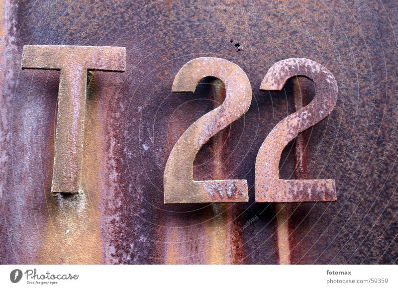 T 22 Digits and numbers Letters (alphabet) Iron Metal Rust Derelict
