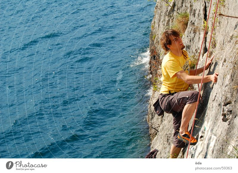 Climbing on Lake Garda Wall (building) Man Rescue Rope Belt Movement Sports Mountain sport climbing Water Blue Climbing rope
