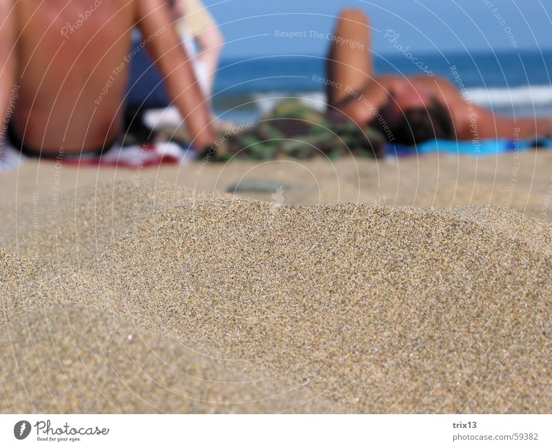 Human being Sky Man Water Beach Vacation & Travel Ocean Far-off places Relaxation Sand Warmth Stone Dream Legs Brown Waves