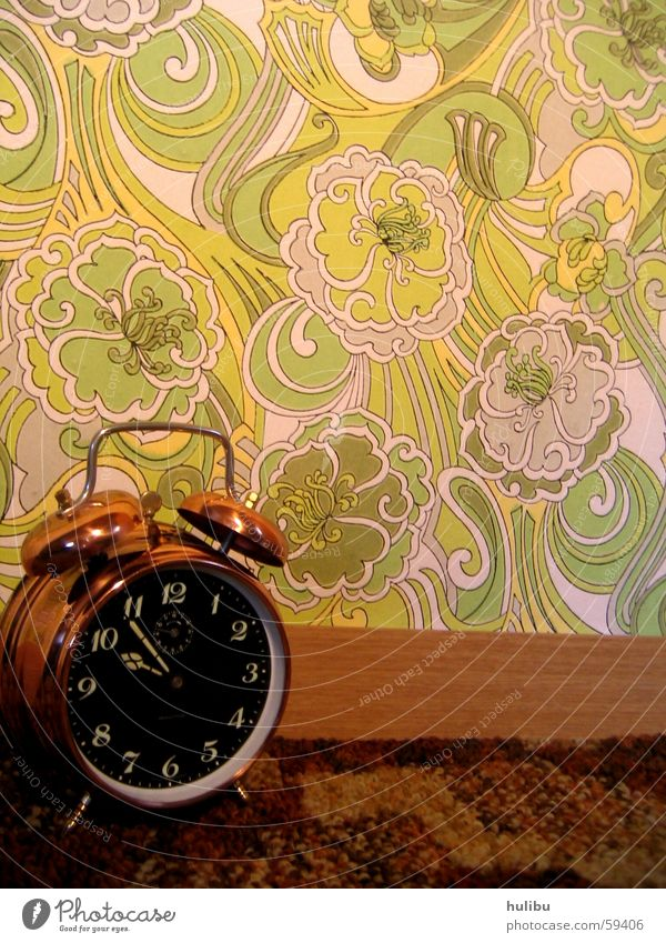 ring ring Alarm clock Clock Wall (building) Wallpaper Multicoloured Buttons Pattern Flower Flowery pattern Seventies Sixties Clock face Carpet Brown Green