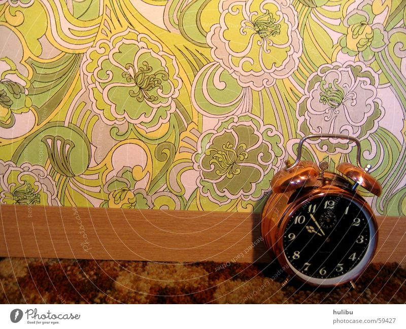 ring ring 2 Alarm clock Clock Wall (building) Wallpaper Multicoloured Buttons Pattern Flower Flowery pattern Seventies Sixties Clock face Carpet Brown Green