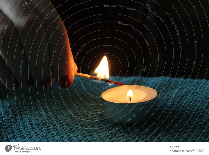 Light a candle Hand Fingers Fire Autumn Winter Candle Touch Relaxation Illuminate Warmth Yellow Orange Turquoise White Moody Safety (feeling of)