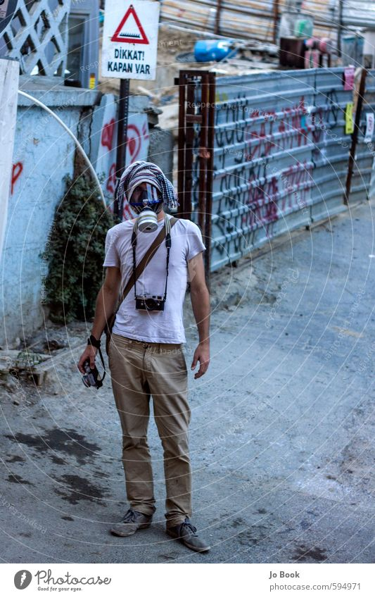 Gezi Park Demonstrant Gasmask Photographer Documentator Human being Youth (Young adults) Man City 18 - 30 years Young man Adults Wall (building) Life Wall (barrier) Park Masculine Facade Door Places Crazy
