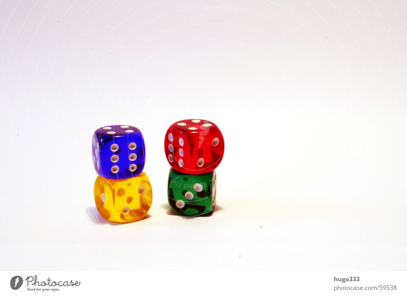 four stacked cubes harmonizing in front of a white background Playing Throw dice 4 Green Red Yellow Disaster Consecutively Eyes Blue Happy basic-coloured