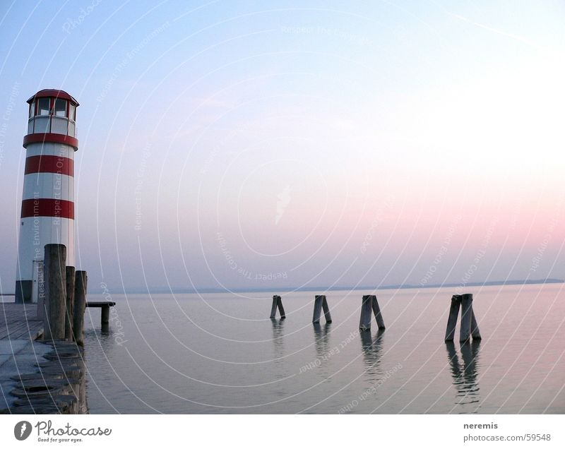 Silence (...dynamics) Lighthouse Lake Calm Footbridge Jetty Far-off places Exterior shot Podersdorf am See Sunset Dream Relaxation Austria Water Sky Freedom