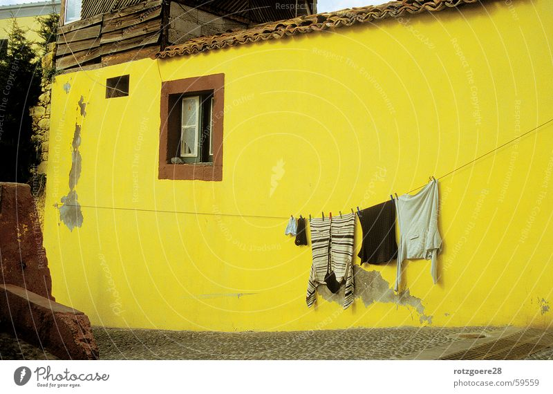 yellow tinge House (Residential Structure) Madeira Yellow Wall (building) Laundry Clothesline Clothing Old Sun Lighting Architecture