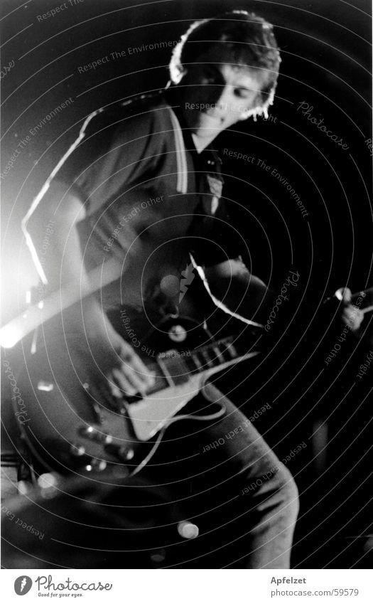 Man Rock music Guitar Musician Pop music Light show Rocker Electric guitar