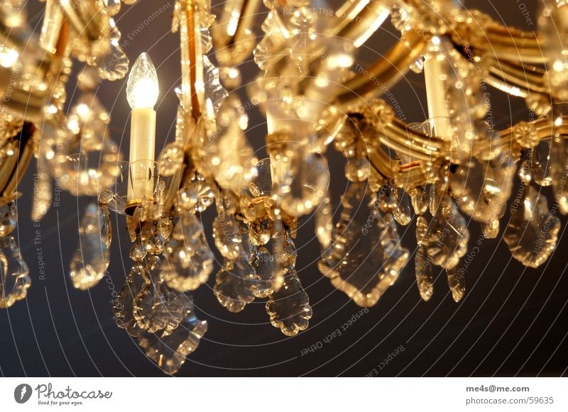 ...neither. Chandelier Tasty Beautiful Luxury A matter of taste Candlestick Lead crystal Lighting engineering Lighting element Refraction Precious stone