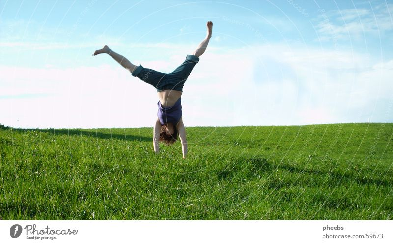 upside down Grass Meadow Gymnastics Woman Go crazy Green Clouds Lawn Stomach Shadow Blue Nature Freedom