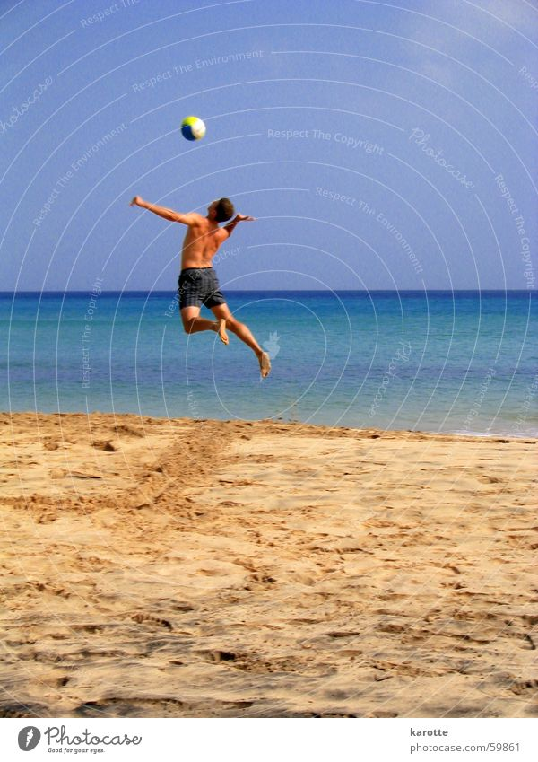 ... and over with it! Volleyball (sport) Service Jump Force Ocean Atlantic Ocean Fuerteventura Beach Weightlessness Exterior shot Tall Sand sea Energy industry