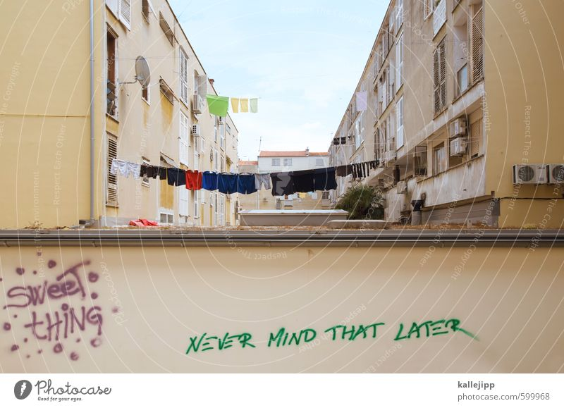 never mind ... Town House (Residential Structure) Building Architecture Wall (barrier) Wall (building) Facade Balcony Characters Graffiti Creativity Clothesline