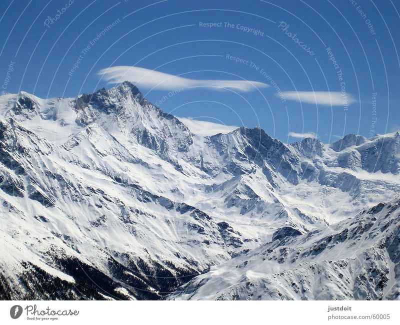 Sky White Blue Clouds Far-off places Cold Snow Mountain Freedom Dream Air Ice Weather Empty Switzerland