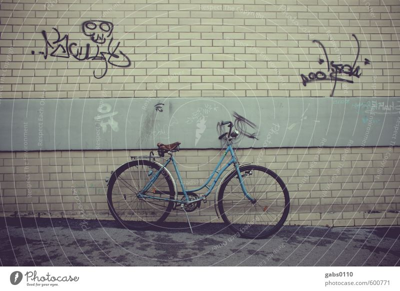Discontinued model. Old, but good. Transport Cycling Graffiti Blue Brick Brick wall Concrete Gray Yellow Saddle Leather puch Downward Ladies' bicycle Retro Town