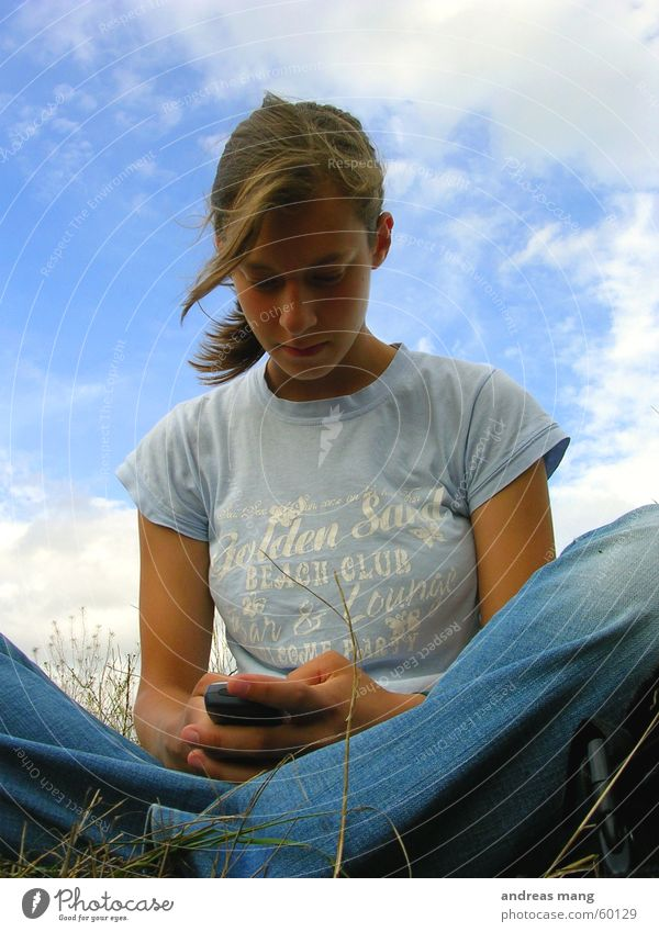 Woman Sky Telephone Clouds Grass Hair and hairstyles Field Wind Human being Sit Write Cellphone Telecommunications SMS