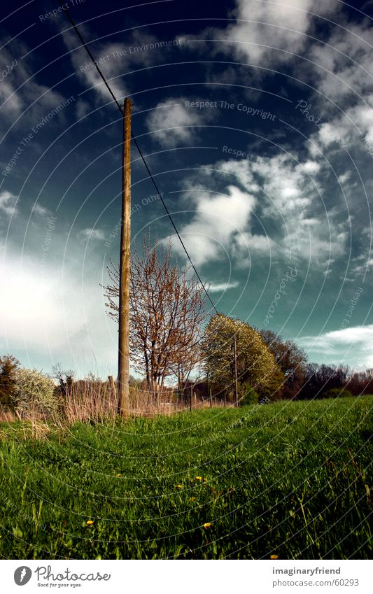 on a wire Electricity pylon Countries Clouds Grass Meadow Sky country Landscape