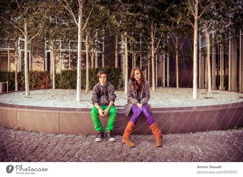 Two teenagers sitting around Lifestyle Trip Sightseeing Summer Human being Masculine Feminine Woman Adults Man Brothers and sisters Sister Youth (Young adults)