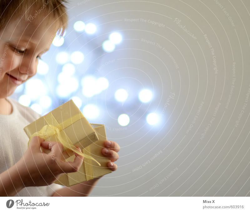 Human being Child Christmas & Advent Joy Emotions Playing Happy Moody Leisure and hobbies Illuminate Infancy Birthday Smiling Gift Hope Curiosity