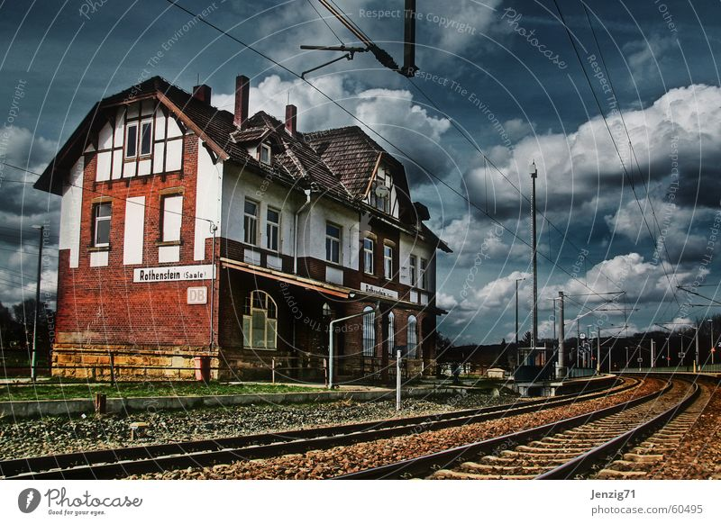 Province. Railroad Railroad tracks Overhead line Clouds Half-timbered facade Half-timbered house Train station Soft Sky