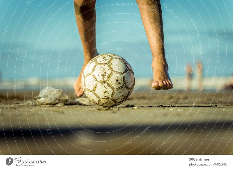 Playing football on the beach Lifestyle Leisure and hobbies Soccer Vacation & Travel Summer Summer vacation Sun Beach Sports Ball sports Human being Masculine