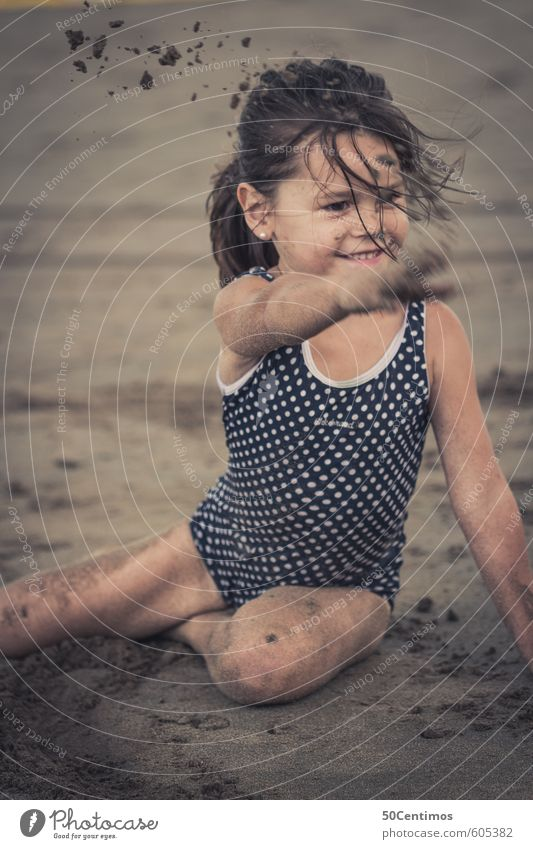 Little girl playing sand on the beach Healthy Leisure and hobbies Playing Vacation & Travel Tourism Trip Far-off places Summer Summer vacation Sun Beach Ocean