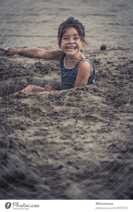 Playing sand on the sandy beach Luxury Leisure and hobbies Children's game Vacation & Travel Tourism Trip Far-off places Summer Summer vacation Sun Beach Ocean