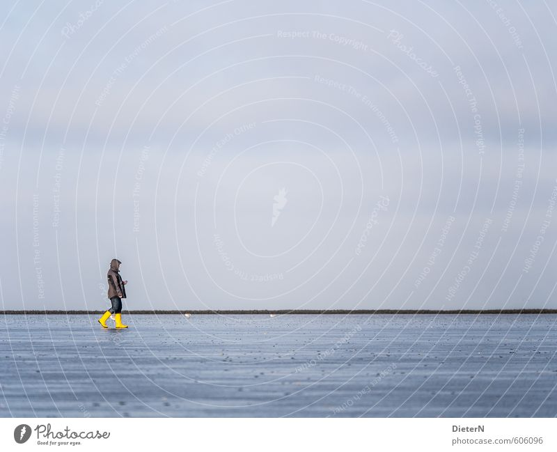 yellow 1 Human being Sand Water Sky Coast Beach Blue Yellow Gray Rubber boots Colour photo Copy Space left Copy Space right Copy Space top Copy Space bottom