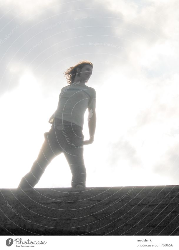 on the castle wall Man Merlon Posture Style Light heartedness Elated Sky Sun Wind Hair and hairstyles Freedom