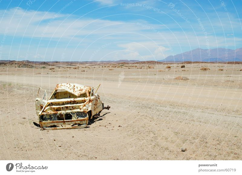 Cart in the sand Dry Gloomy Gravel Crate Namibia Africa Scrap metal Dangerous Sky Blue partly cloudy Desert Calm Stone Street Ski run Rust Threat