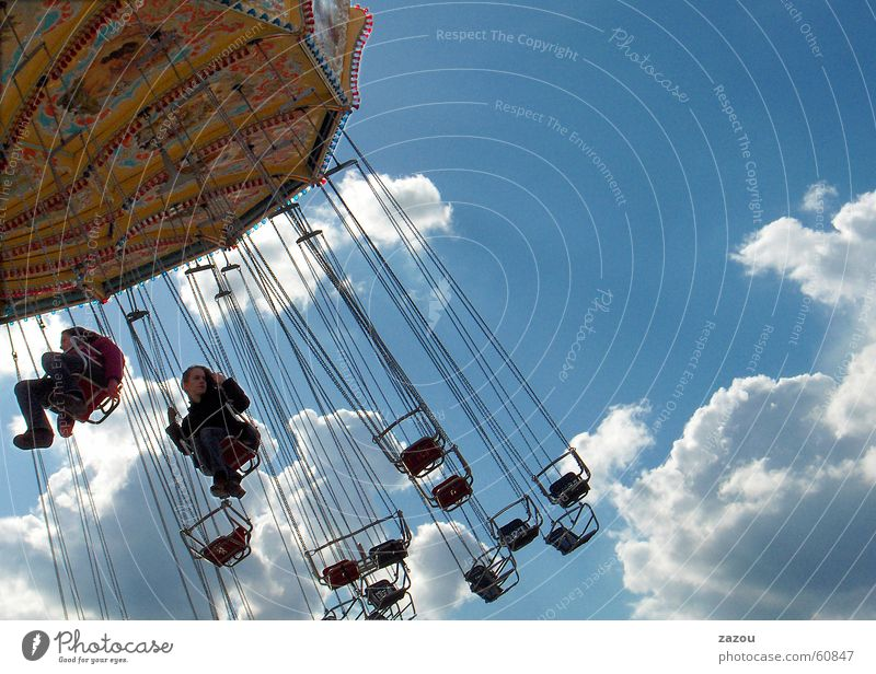 Child Girl Sky Joy Clouds Freedom Feasts & Celebrations Fairs & Carnivals Hover Oktoberfest Carousel Recklessness Showman